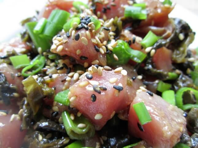 ahi poke with green onions and black sesame seeds